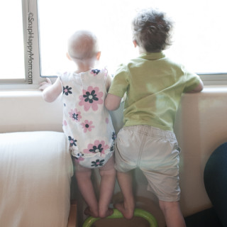 two kids looking out window