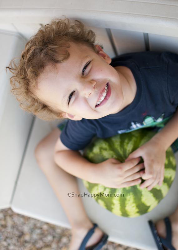 boy holding watermelon