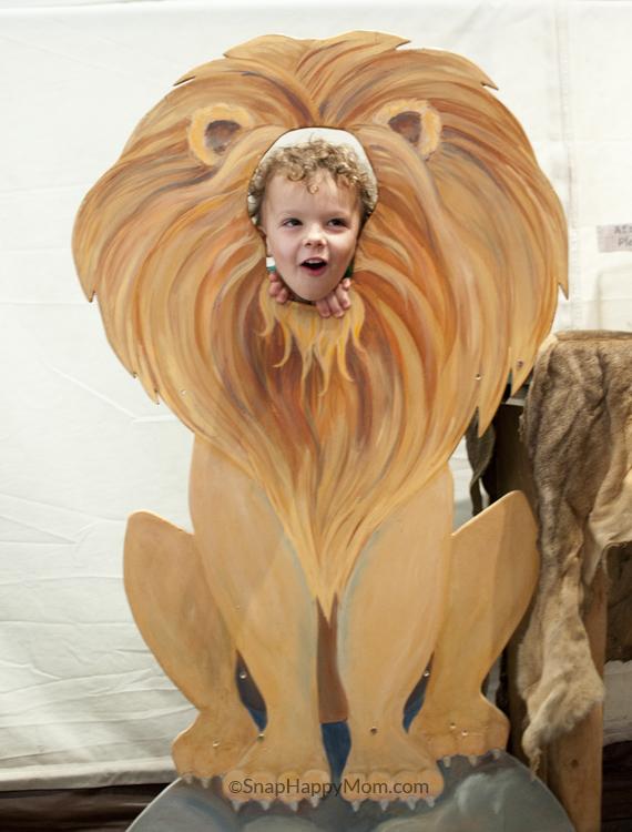child pretending lion