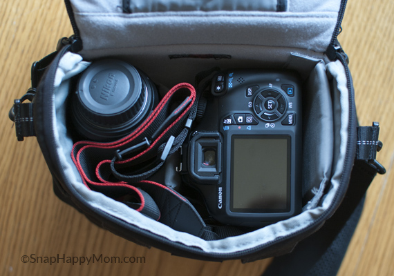 NOT the safest way to put a DSLR in bag - www.SnapHappyMom.com