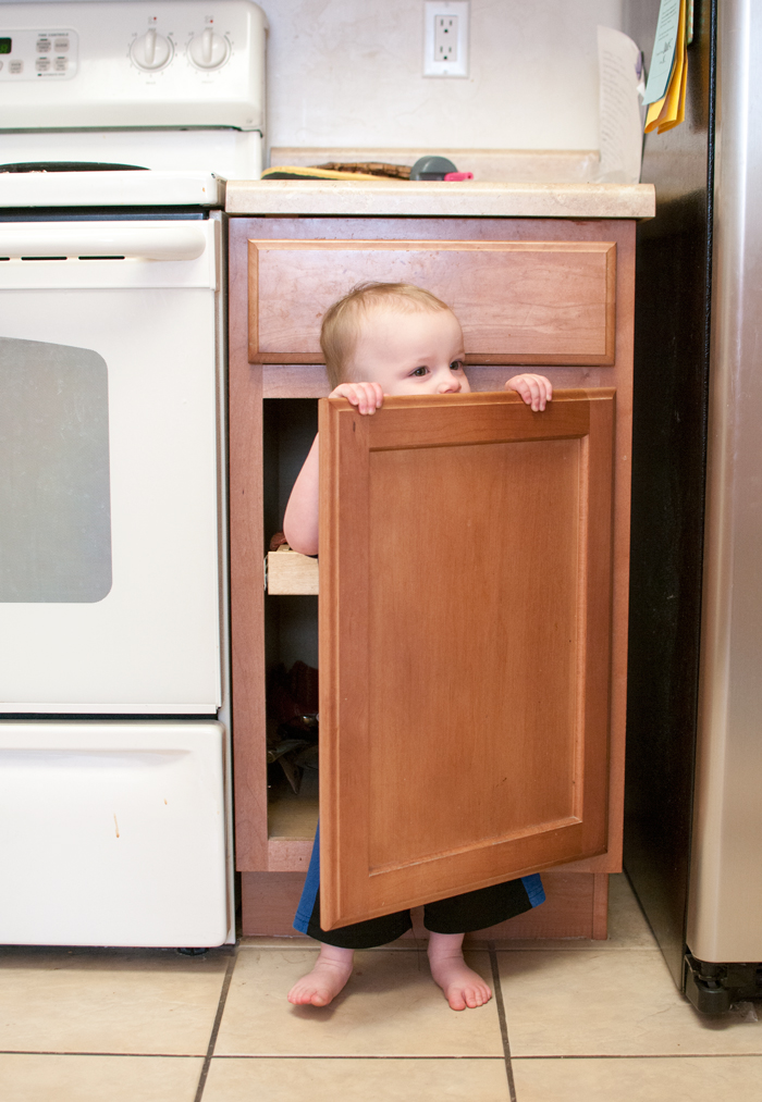 Hiding in cupboards is fun! - SnapHappyMom.com